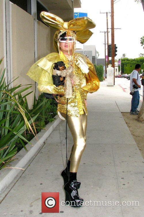 Posing for photographers on Melrose Avenue while wearing...
