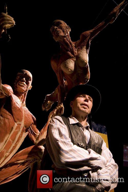 Dr. Gunther von Hagens poses with one of...