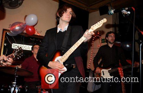 Nikolai Fraiture of the Strokes  performing with...