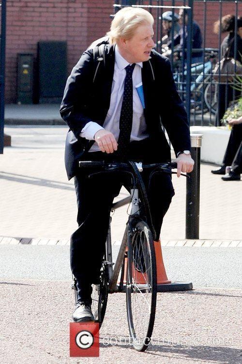 Boris Johnson arriving by bicycle to the London...