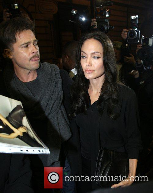 Brad Pitt and Angelina Jolie arriving for a...