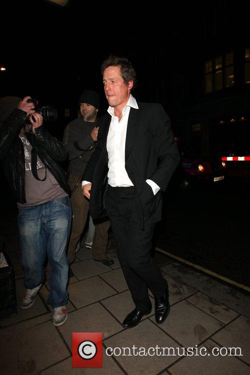 Hugh Grant lashes out at a photographer outside...