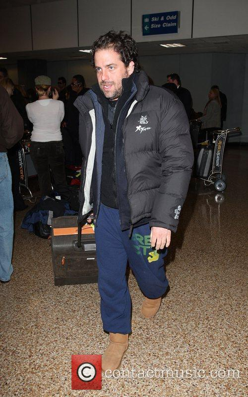 Collects his luggage upon arriving at Salt Lake...