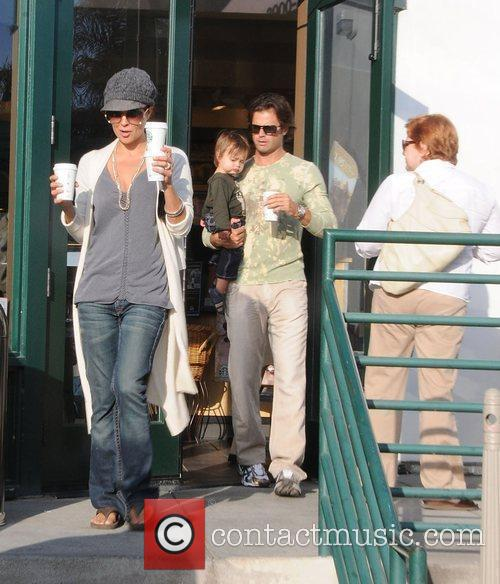 Brooke Burke and David Charvet getting drinks from...