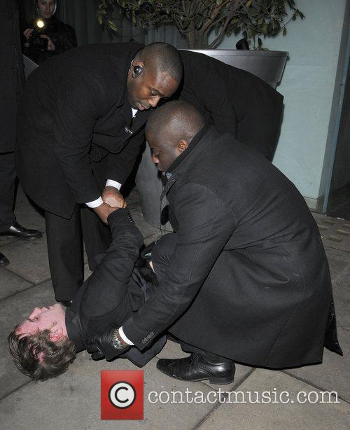 A customer is ejected from Bungalow 8 nightclub...