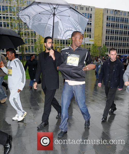 Usain Bolt of Jamaica and Haile Gebrselassie of...