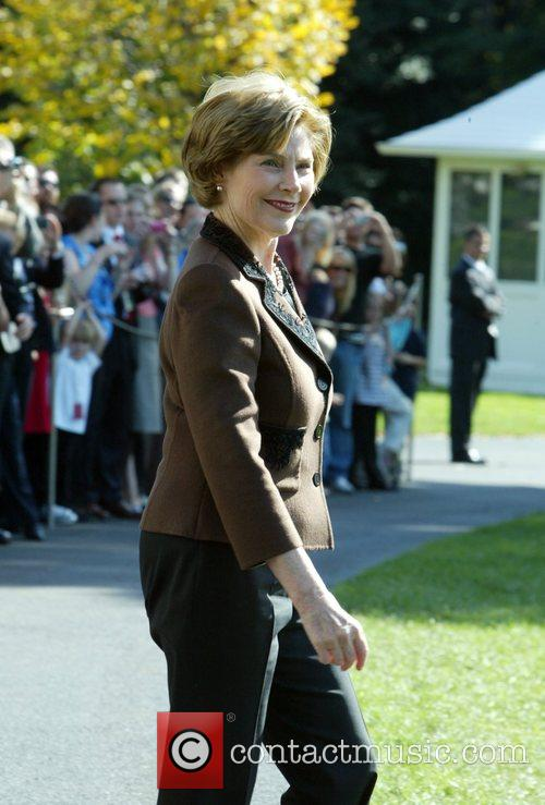 Laura Bush departs from the White House on...