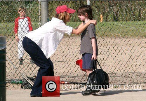 Calista Flockhart and her son, Liam, leaving a...