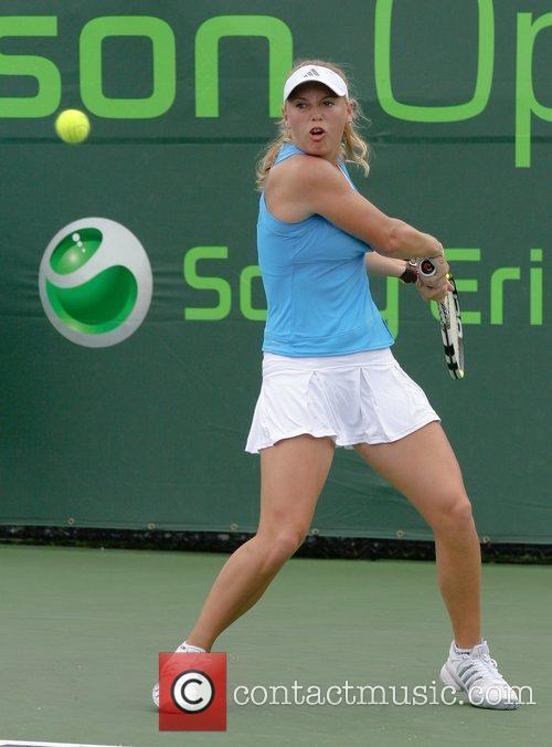 Caroline Wozniacki plays against Patty Schnyder during day...