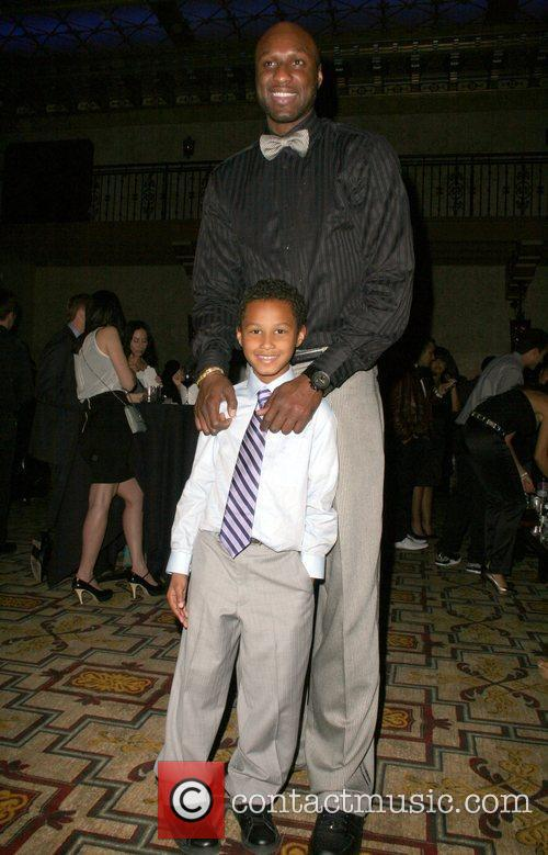 Lamar Odom and son The 5th Anniversary Of...