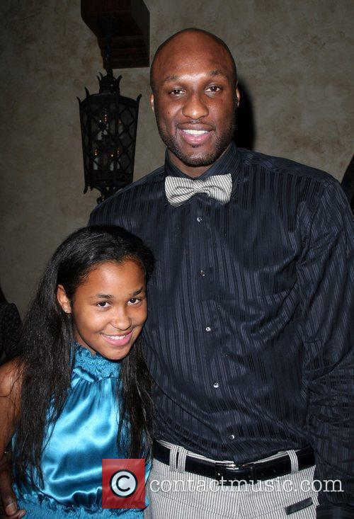 Lamar Odom and daughter The 5th Anniversary Of...