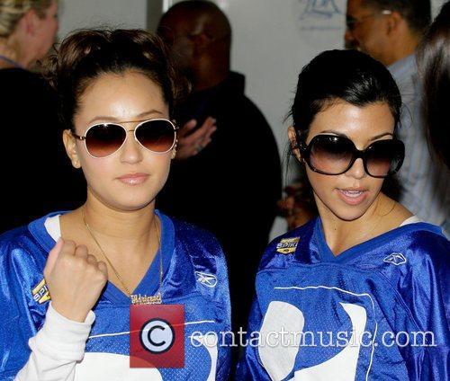 Adrienne Bailon and Kourtney Kardashian The DirectTV 3rd...