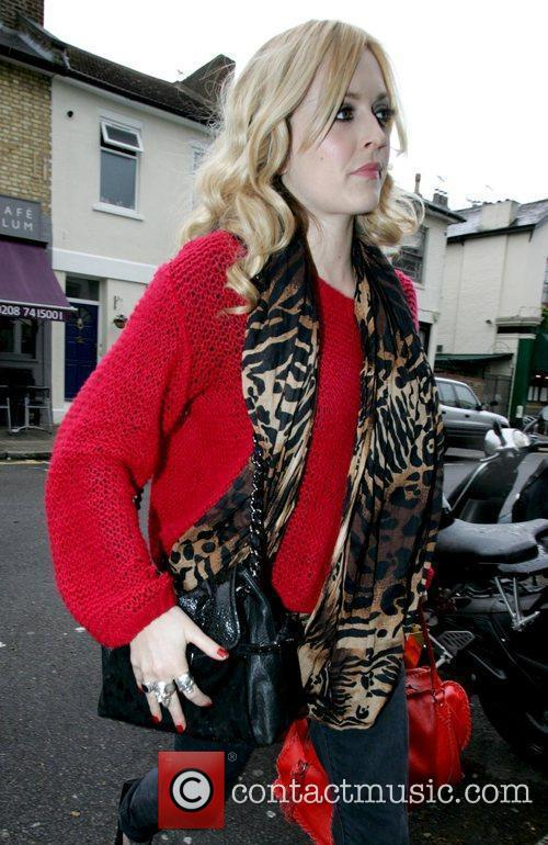 Fearne Cotton, dressed in red, arriving to film...