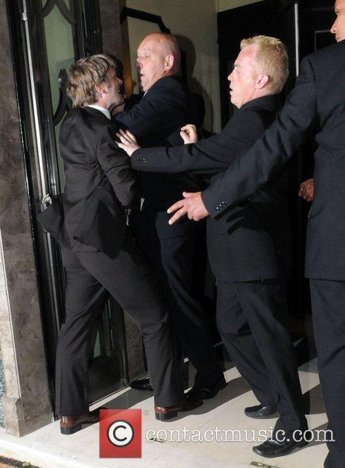Wedding guests break out into a fight outside...