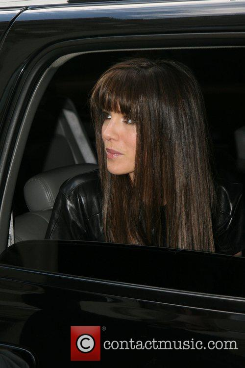 As she leaves her hotel