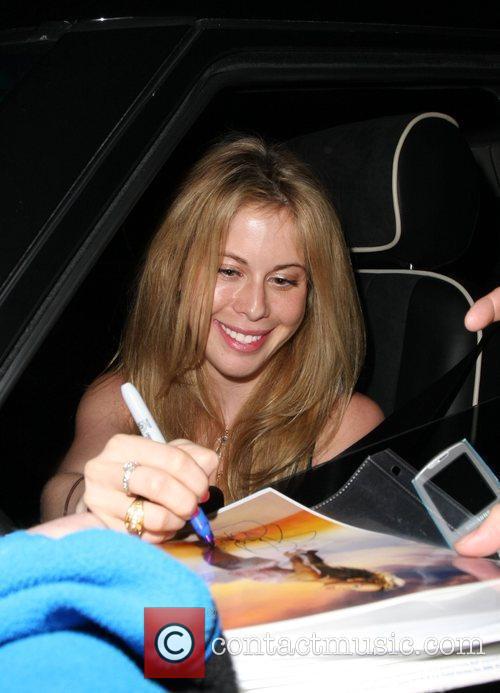 Tara Lipinski signs autographs as she leaves Bar...