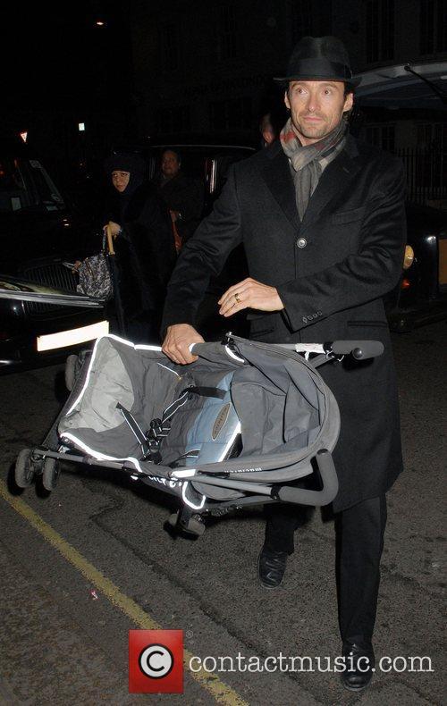 Hugh Jackman seen carrying a buggy arriving at...