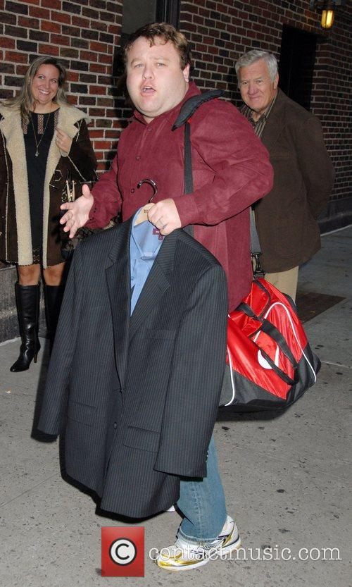 Arrives for the The 'Late Show with David...