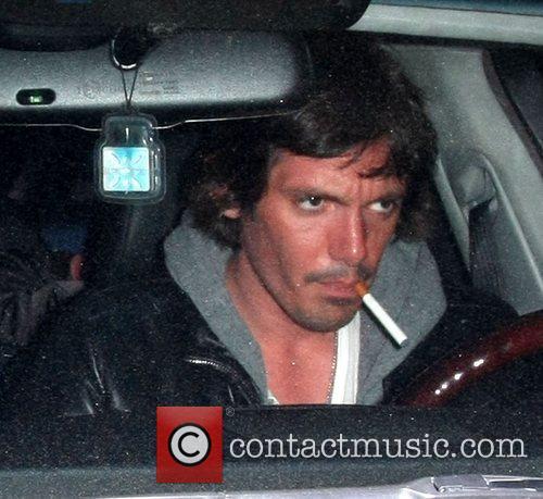 Seen leaving Les Deux Restaurant in his car,...