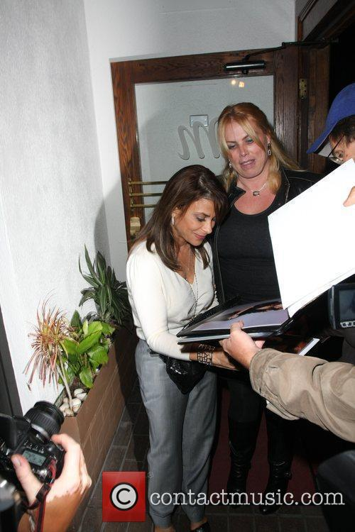 Leaves Madeo's restaurant and is approached by fans...