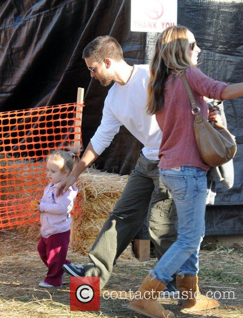 Tobey Maguire and Jennifer Meyer with their daughter...