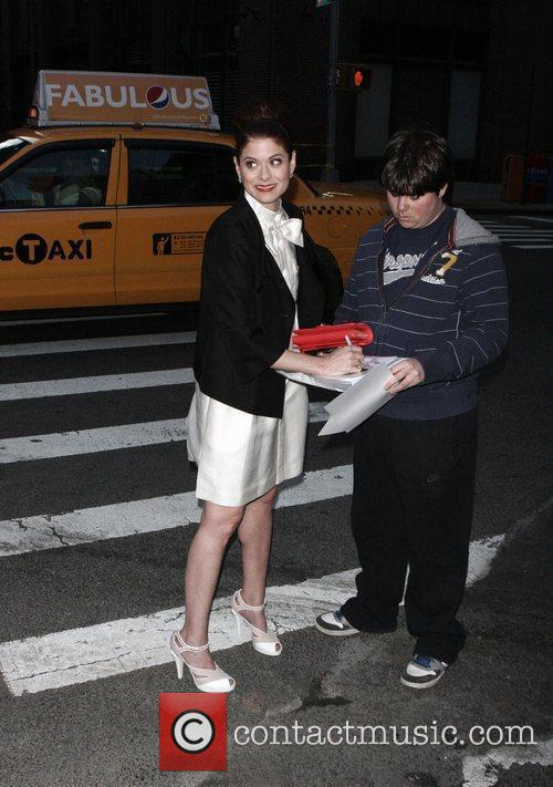 Debra Messing signing an autograph Chanel hosts their...