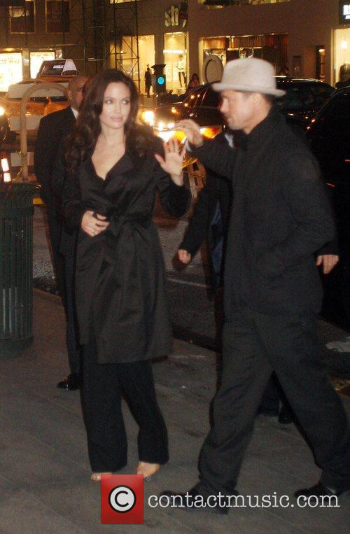 Angelina Jolie and Brad Pitt arriving at a...