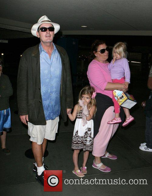 Charlie Sheen taking his daughters Sam and Lola...