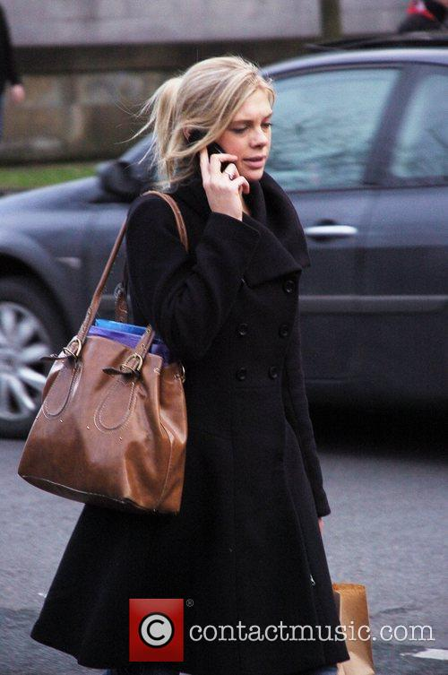 Chelsy Davy chats on her mobile phone as...