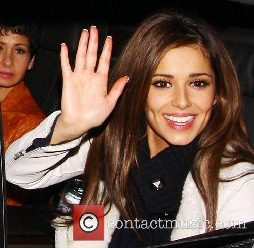 Cheryl Cole gives a smile, wave and thumbs...