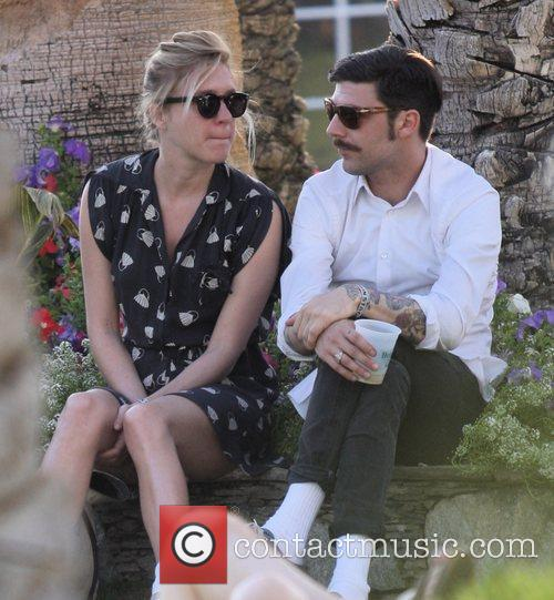 Chloe Sevigny relaxes with a friend at Coachella...