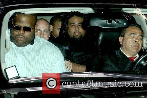 Chris Brown in the back seat leaving Los...