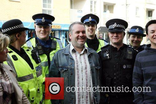 Chris Moyles poses with local police as he...