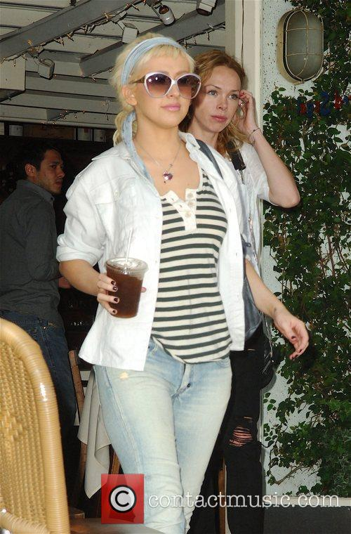 Christina Aguilera spotted shopping at Fred Segal drinking...