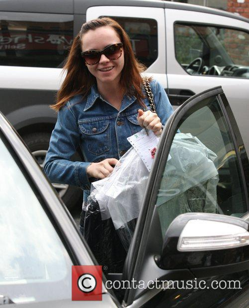 Christina Ricci picks up her laundry from the...
