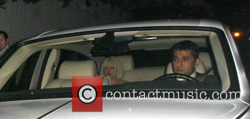 Leaves Bar Marmont in a white car