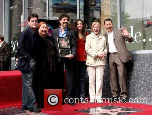 Chuck Lorre and the cast of his show...