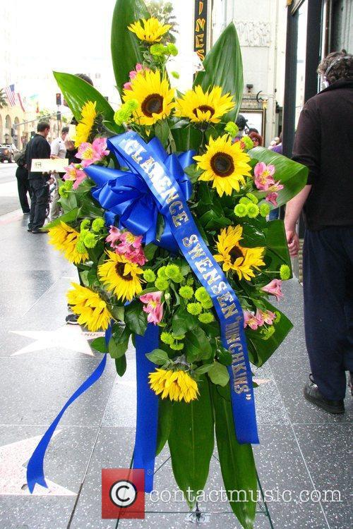A flower arrangement has been placed at the...
