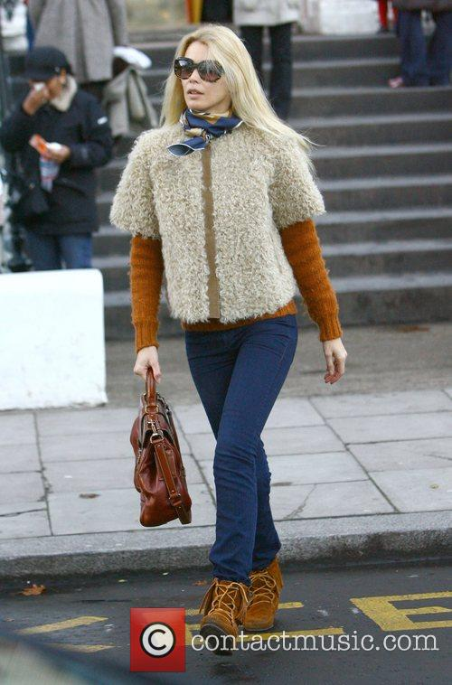 Claudia Schiffer wraps up in wool as she...