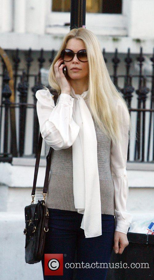 Claudia Schiffer chats on her phone whilst making...