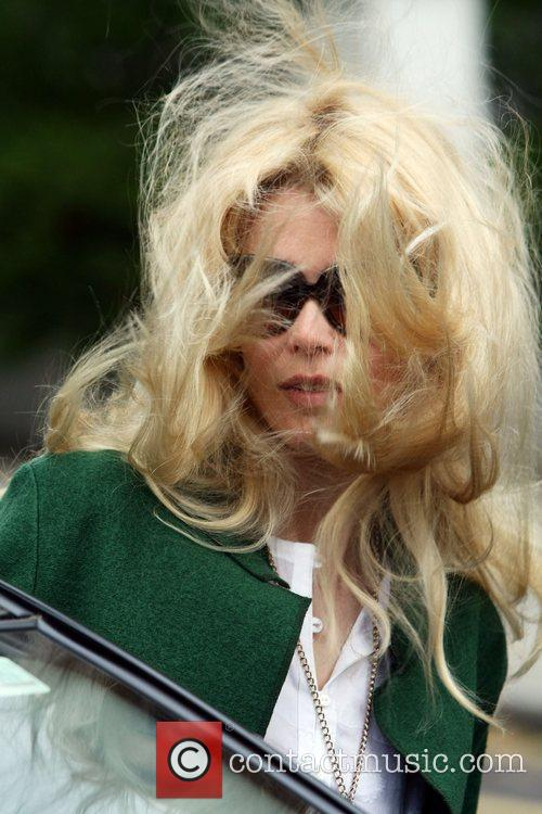 Claudia Schiffer with windswept hair makes her way...