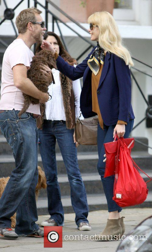 Claudia Schiffer meets a friend and his dog...