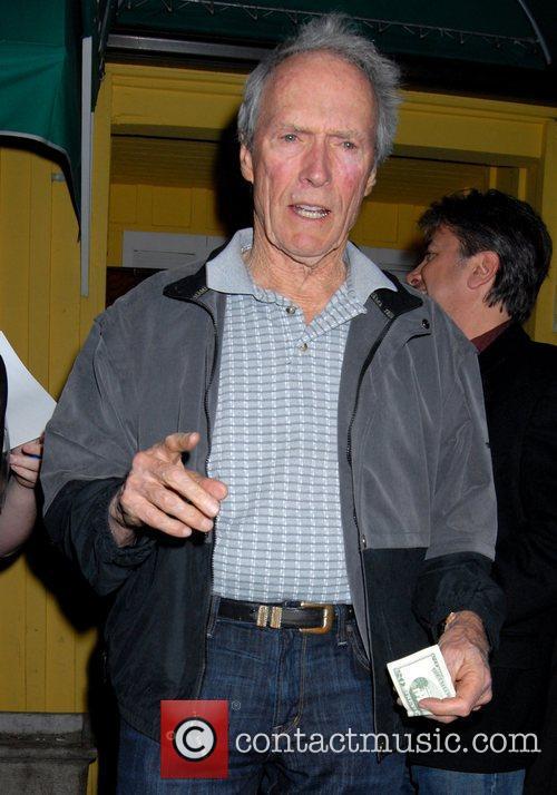 Clint Eastwood leaves Dan Tana's restaurant after having...