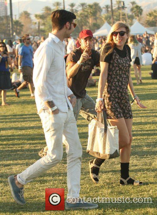 Chloe Sevigny with a male companion at the...