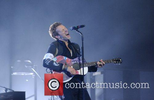 Chris Martin of Coldplay performing at the O2...