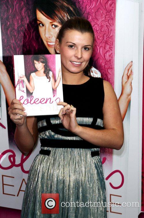 Coleen Rooney signs copies of her recent book...