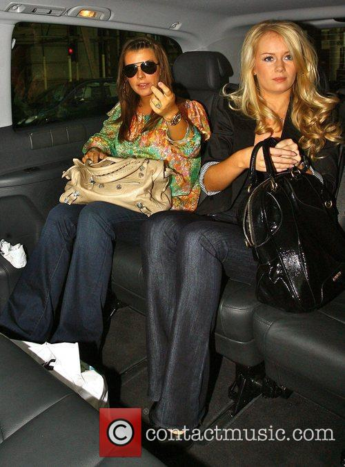 Coleen Rooney gets into a private car after...