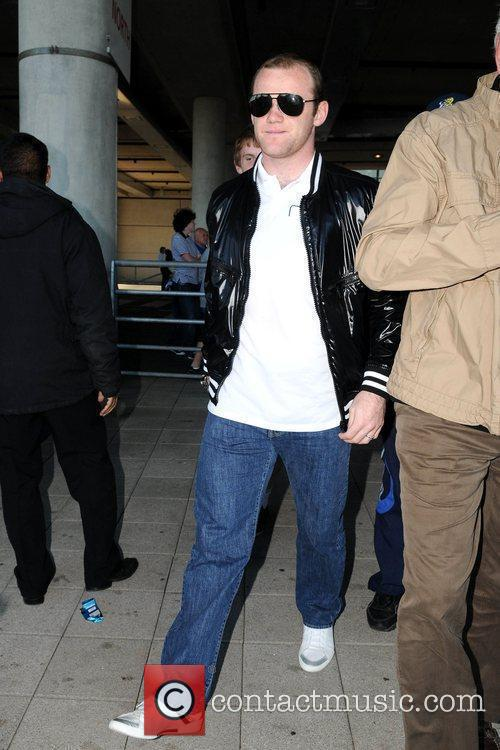 Wayne Rooney leaves the Wembley Arena after watching...