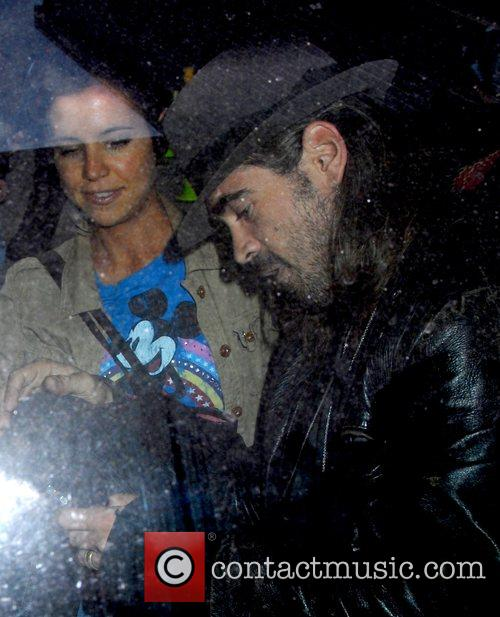 Colin Farrell gets into a taxi while out...