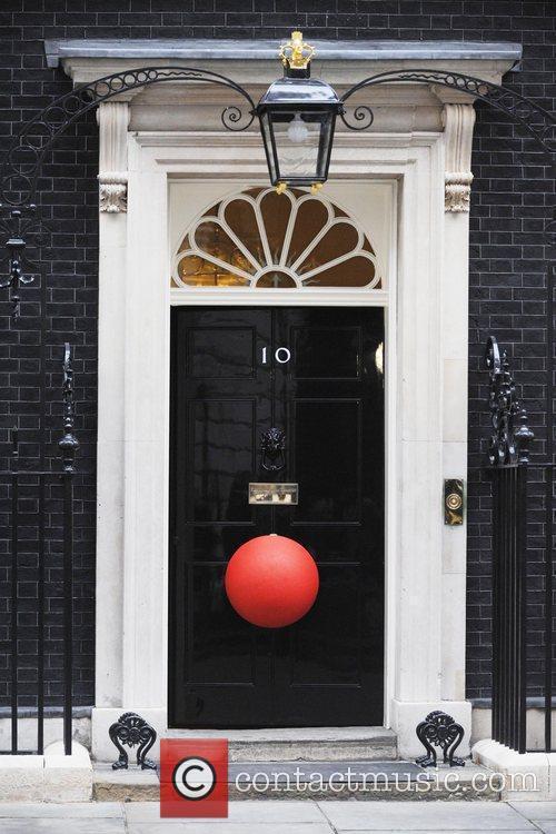 Prime Minister Gordon Brown congratulates a group of...